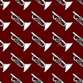 Cute seamless pattern on a red background.Vector hand drawn illustration of trumpet Royalty Free Stock Photo