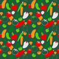 Cute seamless pattern with vegetables on a green background