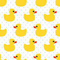 Cute seamless pattern with yellow rubber duck on polka dots background. Royalty Free Stock Photo