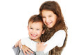 Cute siblings a picture of young hugging over white background Royalty Free Stock Photography