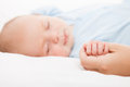 Cute sleeping newborn baby child holding mother hand Royalty Free Stock Photo