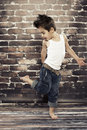 Cute small boy dance in studio Stock Photos