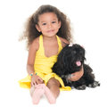 Cute small girl hugging her pet dog isolated on white Stock Photo