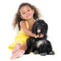 Cute small girl hugging her pet dog isolated on white Royalty Free Stock Images