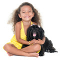 Cute small girl hugging her pet dog Royalty Free Stock Photo