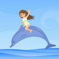 Cute small girl is riding a dolphin Royalty Free Stock Photo