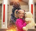 Cute small girl  with toy bear Royalty Free Stock Photo