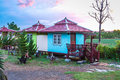 Cute Small Green and Blue Cottage in the Evening Royalty Free Stock Photo