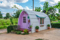 Cute small purple cottage with wave roof Stock Photo