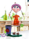 Cute smile doll with a beautiful basket on dining table Royalty Free Stock Photo