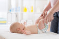 Cute smiling baby gymnastic practice Royalty Free Stock Photo