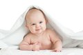 Cute smiling baby kid lying covered by bath towel Royalty Free Stock Photo