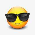 Cute smiling emoticon wearing black sunglasses, emoji, smiley - vector illustration Royalty Free Stock Photo