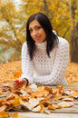 Cute smiling girl sitting in the park Royalty Free Stock Photography