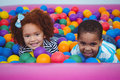 Cute smiling kids in sponge ball pool Royalty Free Stock Photo