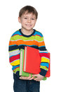 Cute smiling little boy with books a portrait of a against the white background Royalty Free Stock Images