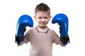 Cute smiling little boy with boxing gloves Royalty Free Stock Photo
