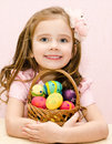 Cute smiling little girl with basket full of easter eggs Royalty Free Stock Image