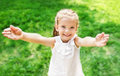 Cute smiling little girl giving her hands on the meadow Stock Images