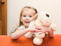 Cute smiling little girl having fun with her toy at home Royalty Free Stock Photo