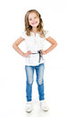 Cute smiling little girl in jeans isolated on white Stock Photo