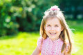 Cute smiling little girl with long blond hair outdoor portrait in summer day Royalty Free Stock Photos