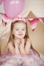 Cute smiling little girl in pink princess vertical portrait of dress celebrating her birthday Royalty Free Stock Image