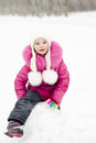 Cute smiling little girl playing outdoor in winter day Royalty Free Stock Images