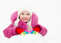 Cute smiling little girl playing outdoor in winter day Stock Photography