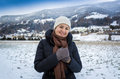 Cute smiling woman posing against high snowy mountains portrait of Stock Image