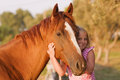 Cute smilling little girl with her handsome horse Royalty Free Stock Photo