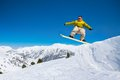 Cute snowboard man jumping handsome in the air in ski park Royalty Free Stock Photo
