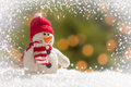 Cute snowman over abstract snow and light background green gold Royalty Free Stock Images