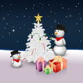 Cute snowmen with christmas tree and presents are decorating the candy canes lights a star topper Stock Photo