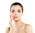 Cute Spa Model Woman with Healthy Skin Touching her Hand her Face. Spa Beauty, Facial Treatment and Cosmetology Concept