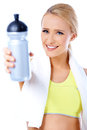 Cute sporty blond woman holding water bottle Royalty Free Stock Photography