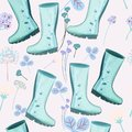 Cute spring pattern with blue rubber boots and flowers for design Royalty Free Stock Photo