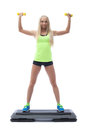 Cute strong blonde doing aerobics on stepper in studio Stock Photo