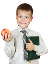 Cute student is holding book and apple. isolated Royalty Free Stock Photography