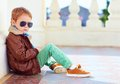 Cute stylish boy in leather jacket and gum shoes portrait of Stock Images