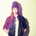 Cute surprised hipster teenage girl with beanie hat closeup studio shot of pretty wearing black leather jacket looking at camera Royalty Free Stock Photography