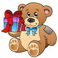 Cute teddy bear with gift Stock Image