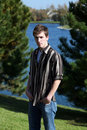 Cute teen boy at lake Stock Photography