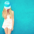 Cute teen girl in blue wall portrait of Stock Photo