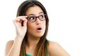 Cute teen girl with glasses looking aside. Royalty Free Stock Photo