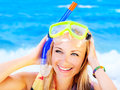 Cute teen girl having fun on the beach pretty closeup portrait summer outdoor woman wearing snorkeling mask female playing water Stock Photography