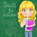 Cute teen girl shows ok at the blackboard back to school Stock Photography