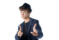 Cute teenage boy in cool pose with hat Royalty Free Stock Photography