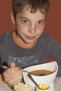 Cute teenage boy eating soup Royalty Free Stock Photo