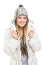 Cute teenage girl with beanie hat and jacket smiling happy caucasian in looking at camera isolated on white background winter Stock Images